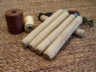 Dog play role made of roled jute with handle