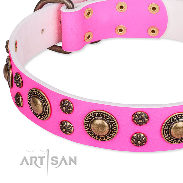 Pink leather dog collar with firmly fixed decorations