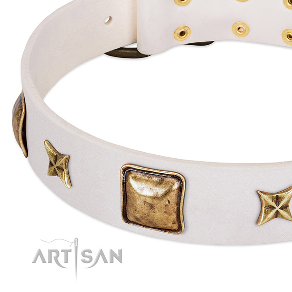 Old bronze-like stars and squares on white leather FDT